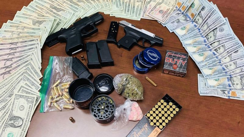 Bainbridge Public Safety says it found a suspect in possession of ecstasy and two firearms...