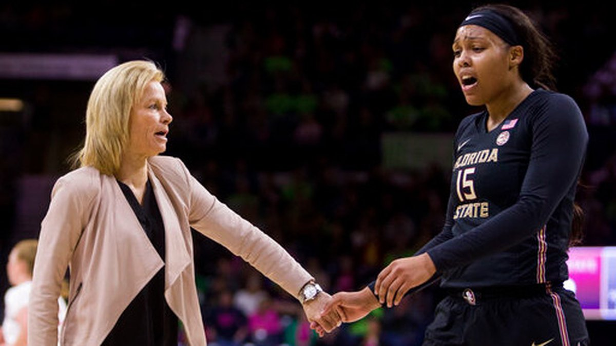 Florida State head coach Sue Semrau greets player Kiah Gillespie (15) on the sideline during a...