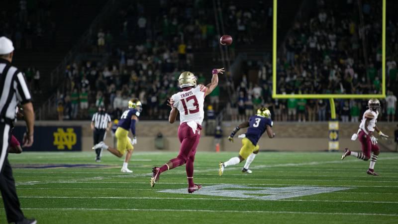 Jordan Travis throws a pass against Notre Dame.