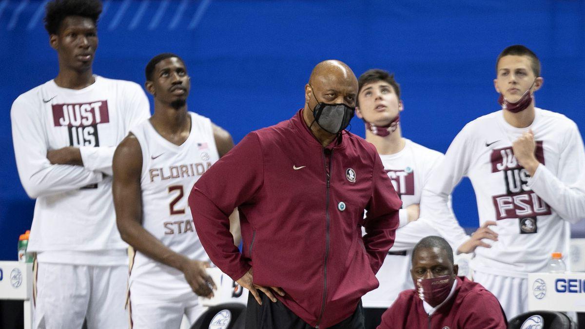 Florida State coach Leonard Hamilton and the Seminole bench watch as Georgie Tech takes a lead...
