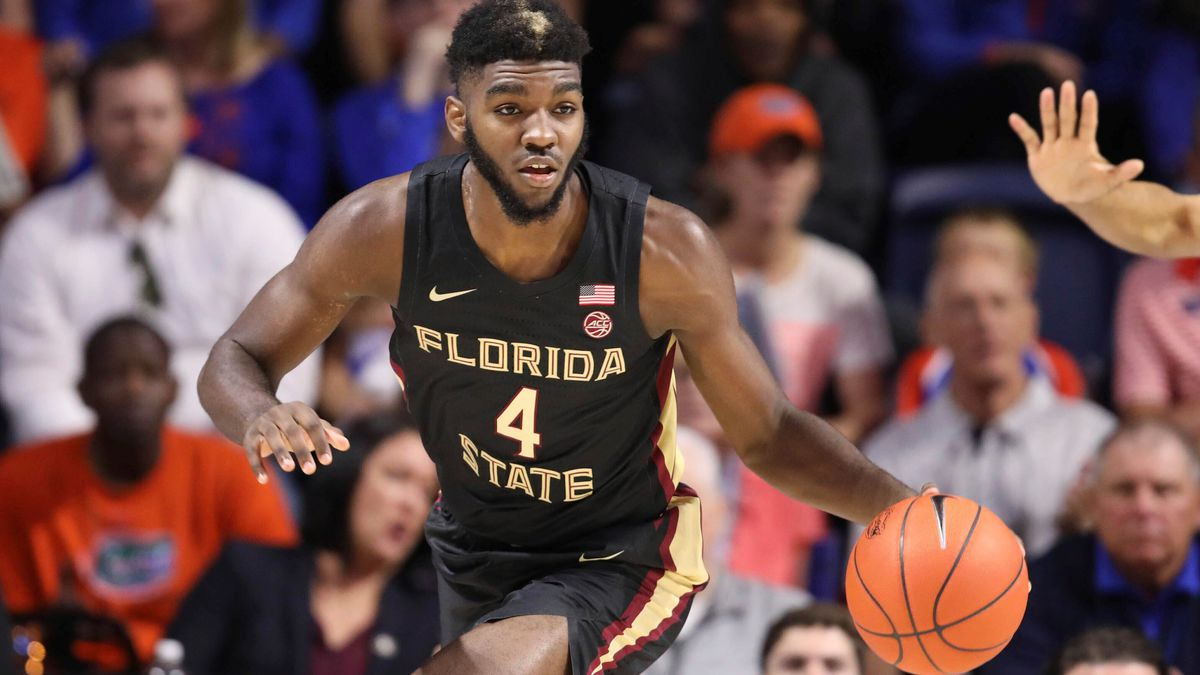 FILE  - In this Nov. 10, 2019, file photo, Florida State forward Patrick Williams (4) dribbles...