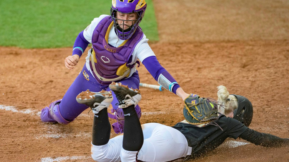 LSU catcher Morgan Cummins (26) doesn't get the tag in time as Florida State infielder Sydney...