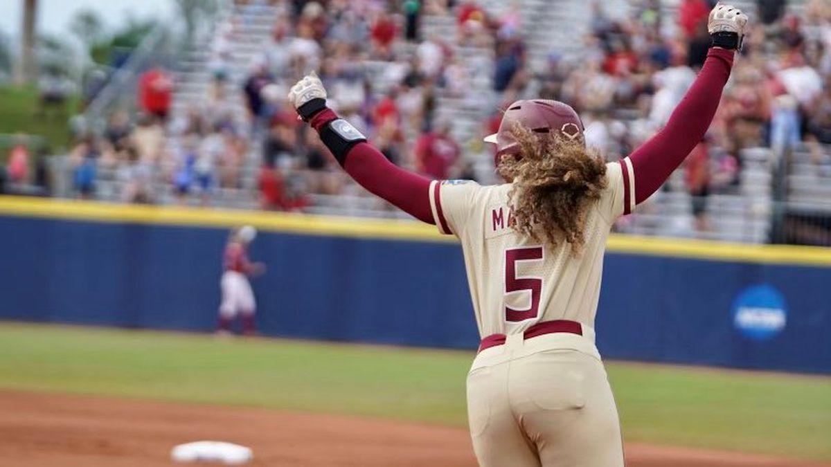 Elizabeth Mason celebrates after hitting a three-run home run in an elimination game against...