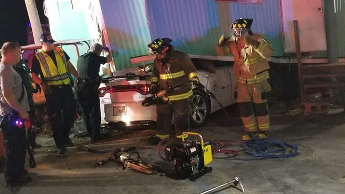 A 2016 Dodge Charger collided with a center median concrete curb and went airborne before...