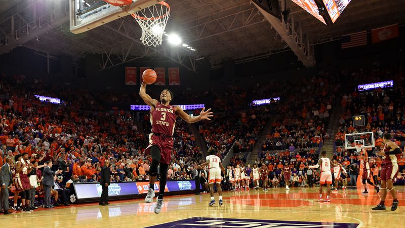 Florida State's Trent Forrest slam dunks into the basket during the second half of an NCAA...