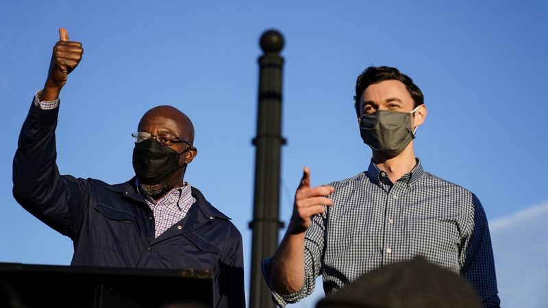 Georgia Democratic candidates for U.S. Senate Raphael Warnock, left, and Jon Ossoff, right,...
