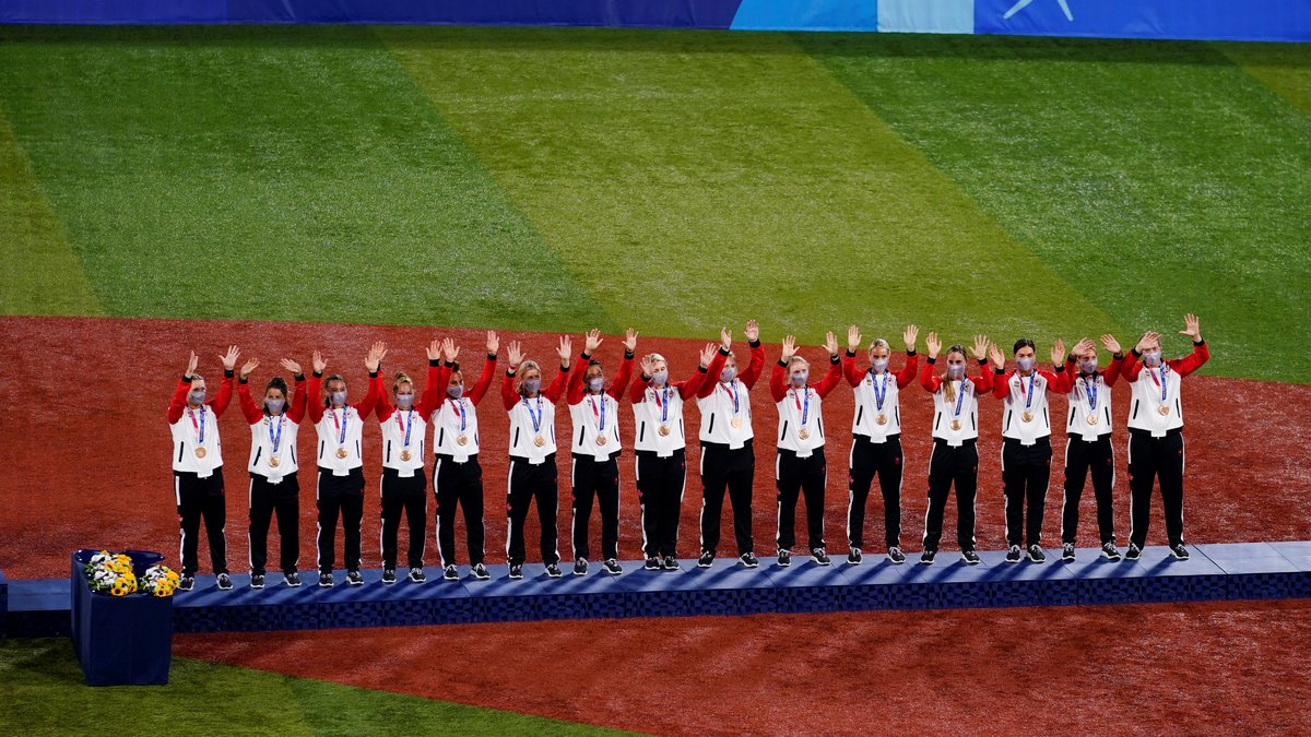 Bronze medalist team Canada celebrate on the podium during the medal ceremony for softball at...