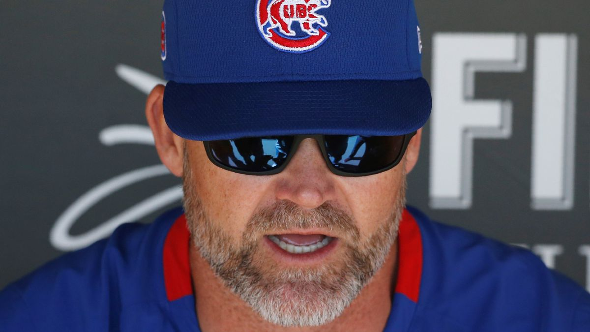 Chicago Cubs manager David Ross speaks to the media in the team dugout prior to a spring...