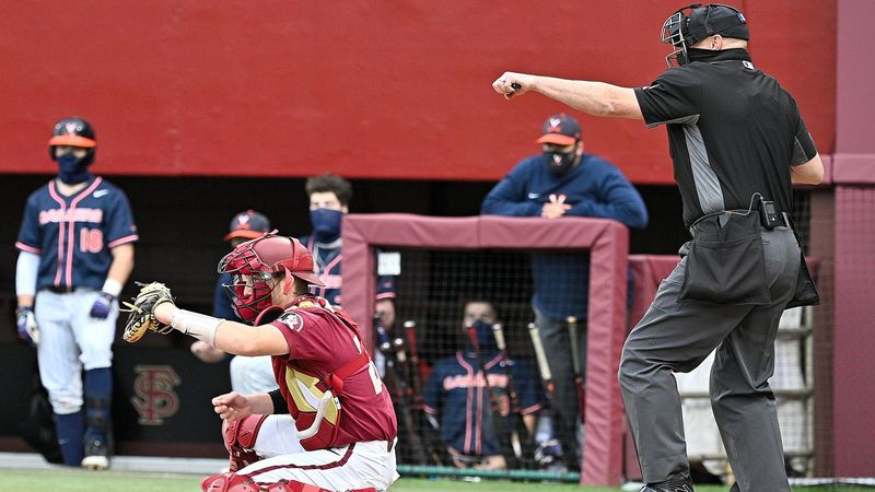 Mathieu Nelson holds the ball behind the plate for a strikeout during FSU's series against...