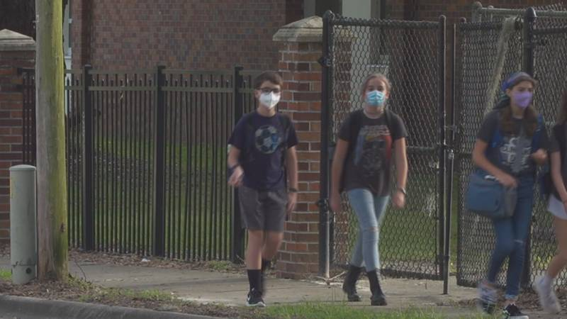 Eight Florida districts have been told they must comply with the state's ruling on masks and...