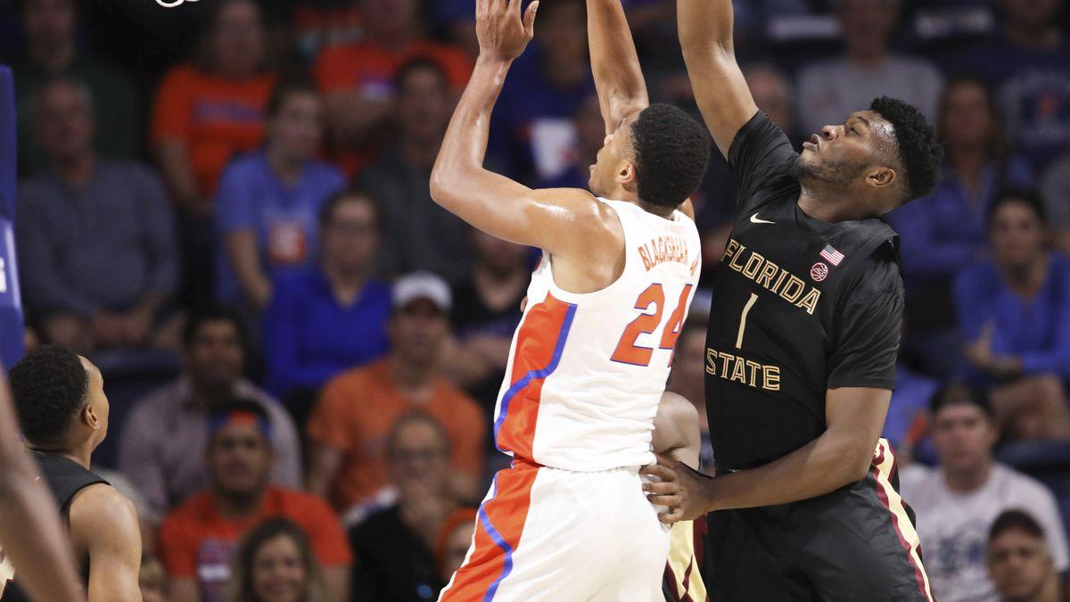 Florida State forward Raiquan Gray (1) blocks the shot of Florida forward Kerry Blackshear Jr....