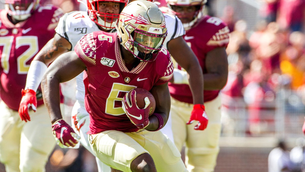 Florida State tight end Tre' McKitty (6) runs against Louisville in the first half of an NCAA...