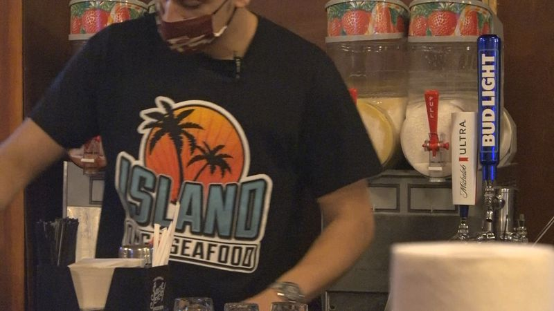 Island OMG Seafood employee preparing drinks for their Valentine's Day Special.