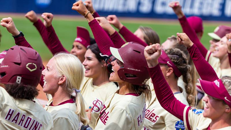Florida State celebrates an elimination game win over Arizona in the 2021 Women's College World...