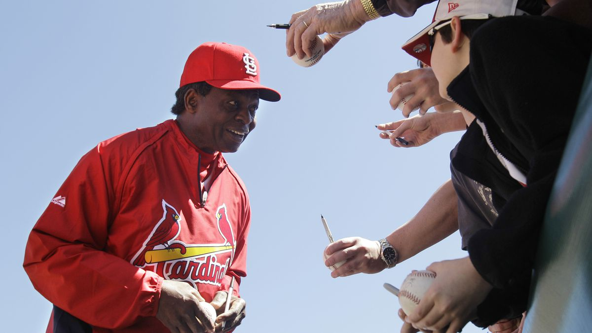 St. Louis Cardinals Hall of Famer Lou Brock signs autographs before a spring training baseball game against the Detroit Tigers, Friday, March 11, 2011, in Jupiter, Fla.