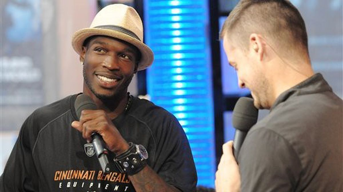 NFL Football player Chad Johnson, left, chats with VJ Damien Fahey during an appearance on MTV's Total Request Live at MTV Studios on Tuesday, July 1, 2008 in New York. (AP Photo/Evan Agostini)