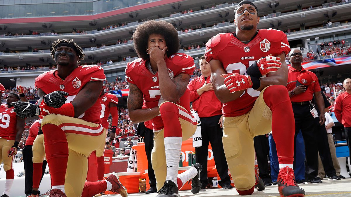 FILE - In this Oct. 2, 2016, file photo, San Francisco 49ers outside linebacker Eli Harold, left, quarterback Colin Kaepernick, center, and safety Eric Reid kneel during the national anthem before the team's NFL football game against the Dallas Cowboys in Santa Clara, Calif.