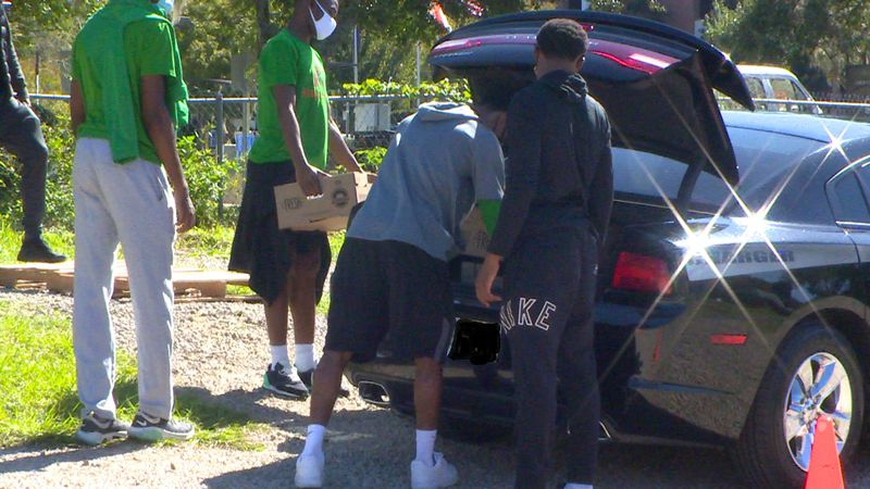 Bethel Missionary Baptist Church handing out food to families in need.