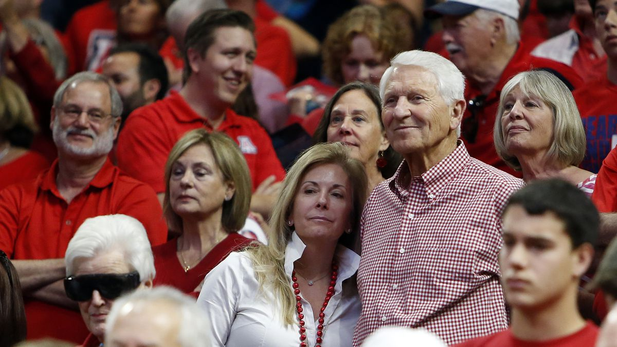 In this March 5, 2016, file photo, Kelly and Lute Olson stand during the second half of Arizona's NCAA college basketball game against Stanford in Tucson, Ariz. Lute Olson, the Hall of Fame coach who turned Arizona into a college basketball powerhouse, has died. He was 85. Olson's family said he died Thursday evening, Aug. 27, 2020. The family didn't provide the cause of death.
