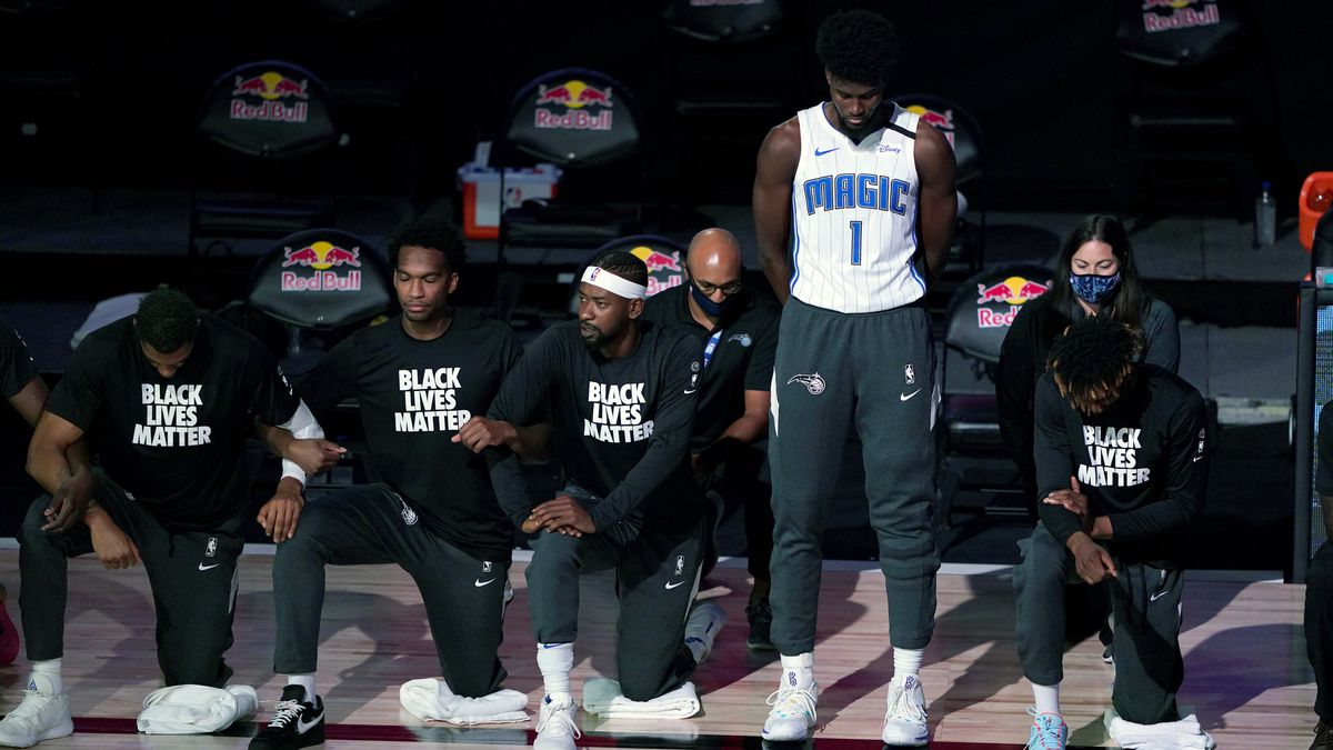 Magic's Jonathan Isaac first in National Basketball Association bubble to stand during anthem
