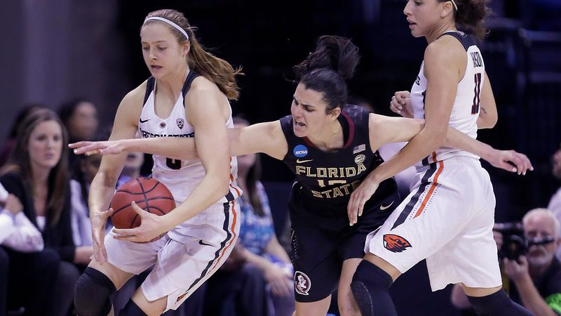 Florida State guard Leticia Romero, center, battles for the ball with Oregon State's Mikayla...