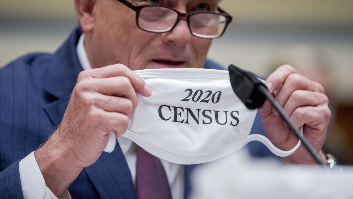 """Census Bureau Director Steven Dillingham holds up his mask with the words """"2020 Census"""" as he testifies before a House Committee on Oversight and Reform hearing on the 2020 Census on Capitol Hill, Wednesday, July 29, 2020, in Washington."""